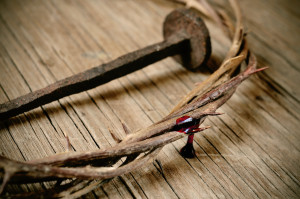the crown of thorns of Jesus Christ and a nail on the Holy Cross